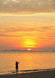 Thailand. Andaman sea. Phi Phi island. Girl. Thailand. Andaman sea. Phi Phi island. Magic sunrise landscape and silhouette of a girl making photos Stock Image