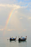 Thailand. Andaman sea. Phi Phi island. Thai boat. S on the calm surface under the bright colorful rainbow Stock Image
