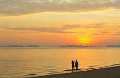 Thailand. Andaman sea. Phi Phi island. Two girls. Thailand. Andaman sea. Phi Phi island. Magic sunrise landscape and silhouettes of two girls making photos Royalty Free Stock Photography