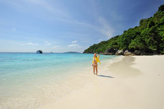 Thailand. Andaman sea. Similan. Beautiful girl. Thailand. Andaman sea. Similan islands. Beautiful girl in yellow walking on the desert beach, surrounded by the Royalty Free Stock Images