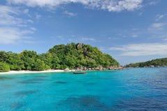 Thailand. Andaman sea. Similan. Boat. Thailand. Andaman sea. Similan islands. Sand beach, calm blue sea, splendid green, big stones and thai boat Stock Photos