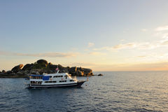 Thailand. Andaman sea. Similan. Diving boat. Thailand. Andaman sea. Similan islands. Calm blue sea, big stones and diving boat at a sunrise Royalty Free Stock Image