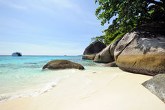 Thailand. Andaman sea. Similan islands. Beach. Thailand. Andaman sea. Similan islands. Sand beach, calm blue sea, splendid green, big stones and diving boat Royalty Free Stock Photography