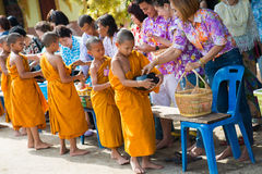 Thailand 13 Apr :: give alms to a Buddhist monk in Songkran Fest Royalty Free Stock Images