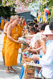 Thailand 13 Apr :: give alms to a Buddhist monk in Songkran Fest Stock Image