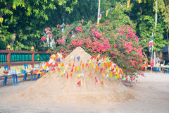 Thailand 13 Apr :: Sand and colorful flag for pray in Songkran F Stock Photography