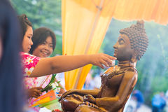 Thailand 13 Apr :: sprinkle water onto a Buddha image in Songkra Royalty Free Stock Photos