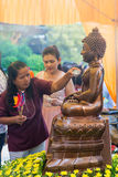 Thailand 13 Apr :: sprinkle water onto a Buddha image in Songkra Royalty Free Stock Photography