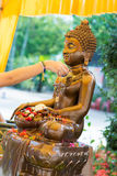 Thailand 13 Apr :: sprinkle water onto a Buddha image in Songkra Royalty Free Stock Photo