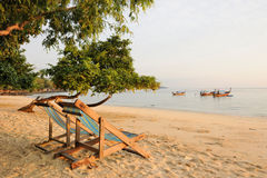 Thailand. Armchairs on the deserted beach. Thailand. Andaman sea. Phi Phi island. Armchairs on the deserted beach with thai boats and islands on the horizon royalty free stock photography