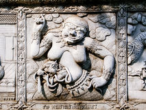 Thailand, Ayutthaya temple wall bass reliefs, carvings of aliens, gods Stock Photos