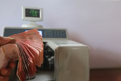 Thailand Baht with money counter machine. Thailand Baht Banknotes with electronic money counter machine Stock Photography