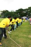 Thailand, Bangkok-April 3. Team of men are helping to tug of war Stock Photos