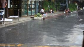 Thailand, Bangkok, 1 August 2014. Road in the city. Road in the city centre during torrential rain. Blurred background. Thailand. 1920x1080 stock video footage