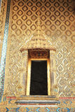 Thailand, Bangkok: door of the golden buddha temple. Ancient Thai pattern style wall and door of temple in grand palace, Bangkok Thailand Royalty Free Stock Images