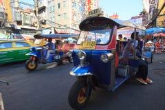 THAILAND,BANGKOK - FEB 24 :Tuk Tuk thailand vehicle symbol parking in Yaowarat Road,the main street in Chinatown, once of Bangkok stock image