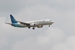 THAILAND,BANGKOK-MAR 3:Garuda Airline plane flying above suvarna Stock Photos