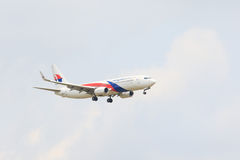 THAILAND,BANGKOK-MAR 3: Malaysia airlines plane flying above suv Royalty Free Stock Image