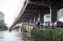 Thailand, Bangkok - November 2011: Car overpass blocked by flooding, Traffic jam on on the bridge royalty free stock images