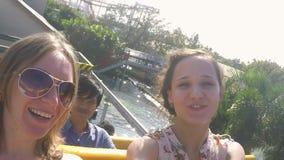 Thailand, Bangkok, 24 november 2015. Cheerful happy girls riding at amusement water theme park. 1920x1080 stock video