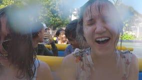 Thailand, Bangkok, 24 november 2015. Cheerful happy laughing girls riding at amusement water theme park enjoying stock footage