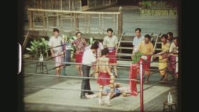 Kick Boxer Knock Out. THAILAND, BANGKOK SAMPRAN RIVERSIDE, MAY 1978. Three Shot Sequence Of Two Muay Thai Kickboxers Beating And Hitting Each Other Until One stock video