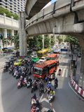 A lot of traffic in cars,motorcycles, bus in Bangkok. THAILAND, Bangkok - September 9, 2018: in the center of the city the metropolitan line colled sky train royalty free stock image