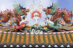 Thailand, Bangkok: temple in Chinatown. Detail of the roof;s temple with a typical mythological dragon Stock Photo