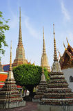 Thailand Bangkok Wat Pho Temple's chedis. In Thailand, in Bangkok the Wat Pho is the most famous Buddhist temple. The temple is known as Wat Phra Chetuphon and Stock Photo
