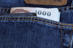 Thailand bank note. And pocket money in the jeans pocket Royalty Free Stock Photo