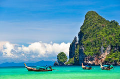 Thailand beach. Beautiful long tail boats in phi phi island, phuket, Thailand Stock Photos