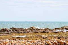 Thailand Beach in Summer Emerald Sea clear Sky stone shore Stock Photos