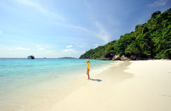Thailand. Beautiful girl in yellow on the beach. Thailand. Andaman sea. Similan islands. Beautiful girl in yellow walking on the desert beach, surrounded by the stock photos