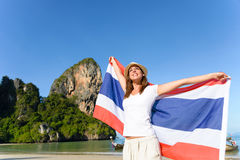Thailand beautiful Krabi beach and woman with flag Stock Image