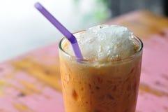Thailand beverage, cold-milk-tea on painted desk. Stock Images