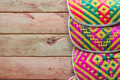 Thailand Blown bamboo weave on wood background. Stock Photos