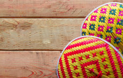 Thailand Blown bamboo weave on wood background. Royalty Free Stock Images
