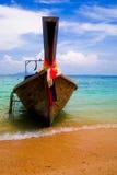 Thailand boat. Thailand wooden boat on sunny sand beach Stock Photo