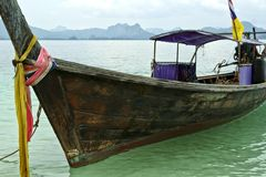 Thailand boating. Wooden longtail boat stoped in a golf, Phuket, Thailand Stock Image