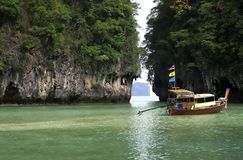 Thailand boating. Wooden longtail boat stoped in a golf, Phuket, Thailand Royalty Free Stock Images