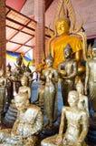 Thailand Buddha Worshippers Gilded with Gold Foils. Bangkok Royalty Free Stock Photo