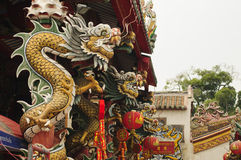 Thailand Chinese dragon pillars in the shrine . Stock Photography
