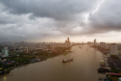 Thailand cityscape. Chaophraya river along side the Bangkok city with cloudy sky Royalty Free Stock Image