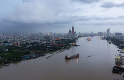 Thailand cityscape. Chaophraya river along side the Bangkok city with cloudy sky Royalty Free Stock Images