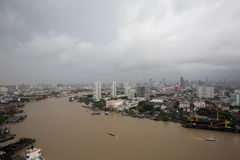 Thailand cityscape. Chaophraya river along side the Bangkok city with cloudy sky Stock Image