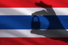 Thailand closed lock in the hand. Import and export of goods from the world market of trade is prohibited. Closed borders royalty free stock photos