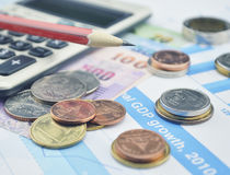 Thailand coins, banknotes, calculator and pencils on business gr Stock Photography