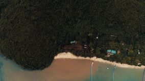 Thailand coral island drone shot water dyed in the color of sand after tropical rain mingles with the clear water of the. The flight and shooting of the stock video