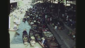 Crowd Of Boats. THAILAND, DAMNOEN SADUAK, DECEMBER 1983. Establishing Shot With Pan And Zoom Over The Busy Colorful Floating Market, Crowded With Sampans, Small stock video footage