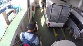 Thailand - 26 December: Man helps woman to pull travel suitcase down the stairs on ferry ship. GoPro first peson view. Koh Phangan stock footage